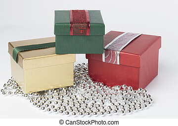 Three presents, red, green and gold