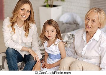 Three pretty females sitting on the sofa - Pleasant time....