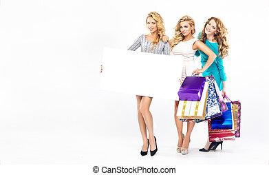 Three pretty ladies on the seasonal sales