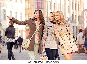 Three pretty women in the crowd