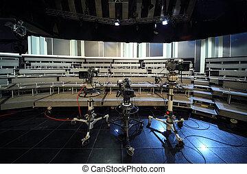 three professional black video cameras in television studio,...