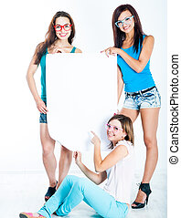 girls holding a blank banner