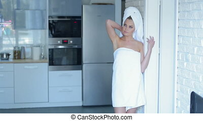 Smiling Young Woman Wearing Bath Towel
