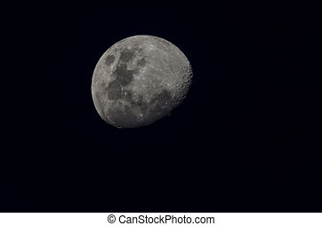 Three-Quarter Moon at Night - Photograph of the Moon showing...