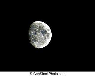 Three quarter moon on the night sky - Three quarter moon...