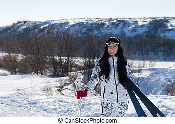Pretty Female Skier Walking at the Snow