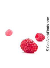 Three raspberries on white
