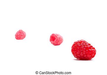 Three raspberries on white
