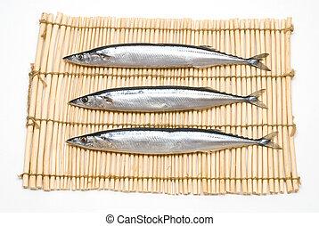 Three raw fish - Three raw pacific saury on the lunch mat