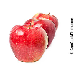 three red apples on a white background