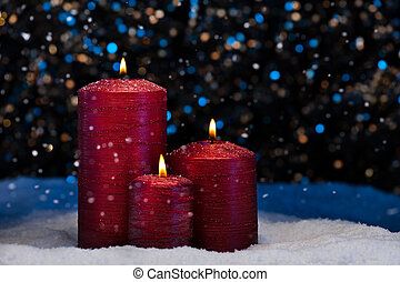 Three Red Candles in snow