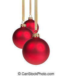 three red christmas balls hanging on ribbon, isolated on...