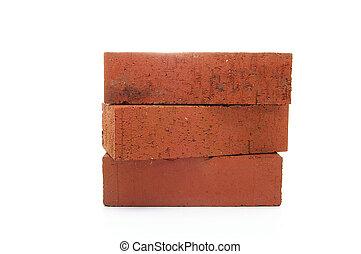 three red clay bricks, isolated on white