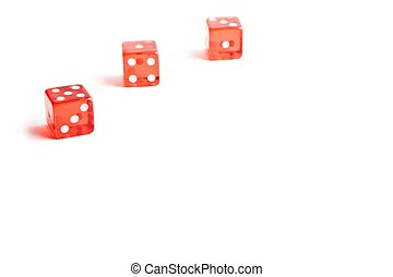 three red dice in a corner on white background