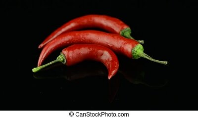 Three red hot peppers