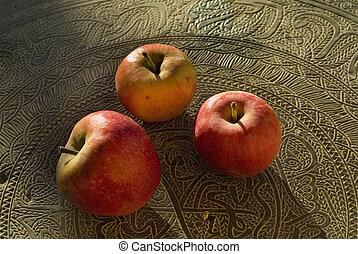 three red organic apples