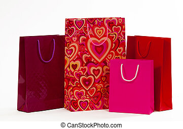 Three red packet with hearts on a white background