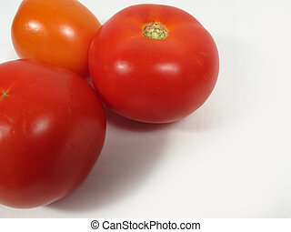 three red ripe tomatoes. isolated on white background. Healthy v