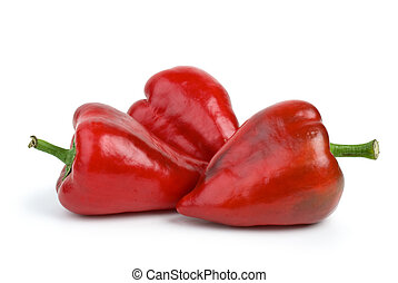 Three red sweet peppers