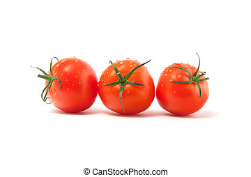 Three red tomatoes isolated on a white background