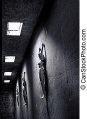 mannequins lying in dark room