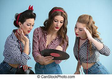Three retro girls with vinyl records.