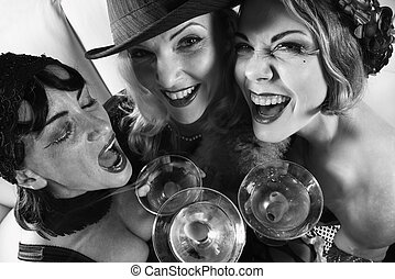 Three retro women drinking. - Three retro prime adult...