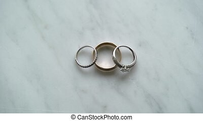 Three rings on marble background