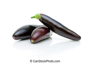 eggplant on a white background close-up - three ripe...