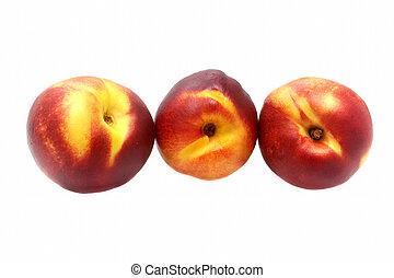 Three ripe nectarine isolated on white background
