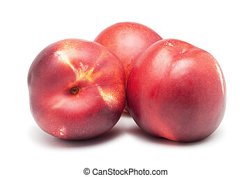 three ripe nectarines isolated on white background
