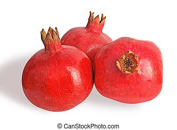 Three ripe pomegranates isolated on white background