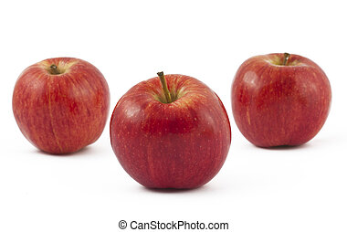 Three ripe red apples on white