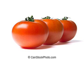three ripe red tomatoes on a white background