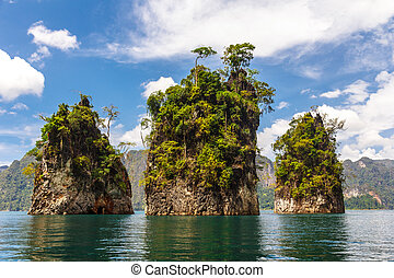 Three rocks in Cheow Lan Lake, Khao Sok National Park,...