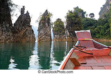 Three rocks in Cheow Lan Lake, Ratchaprapa Dam, Khao Sok National Park, Thailand.