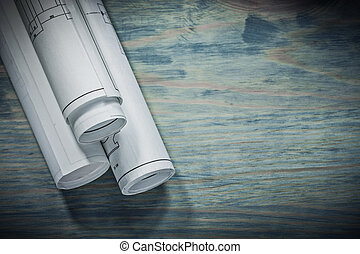 three rolled blueprints close up