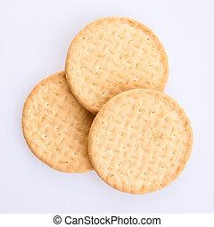 Three round biscuits on a grey background