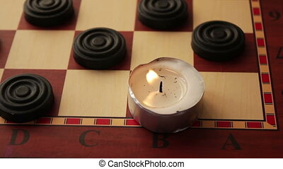 Three round candles on a black background