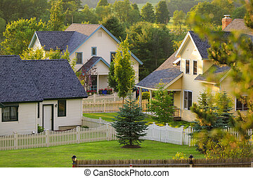 Three rural homes with white picket fences. - Three rural...