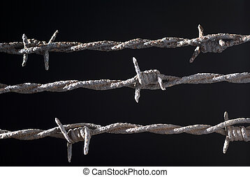 barbed wire - three rusty barbed wire on black background