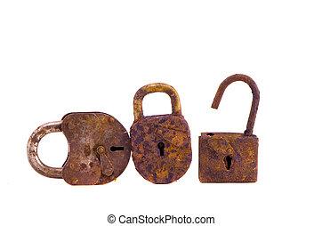 three rusty lock isolated on white