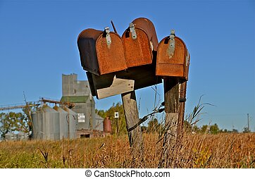 Three Rusty Rural Mailboxes