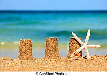 Three sand towers on beach