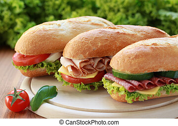 Three Sandwiches - Closeup of three fresh sandwiches with...