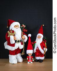 Three Santa Claus figures