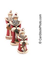 Three Santa figures isolated