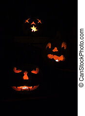 Three scary jack o\'lanterns vertical