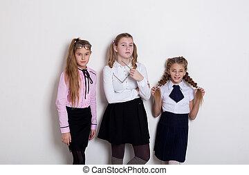 three schoolgirls in class at the school