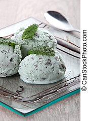 Three scoops of ice-cream on a plate.